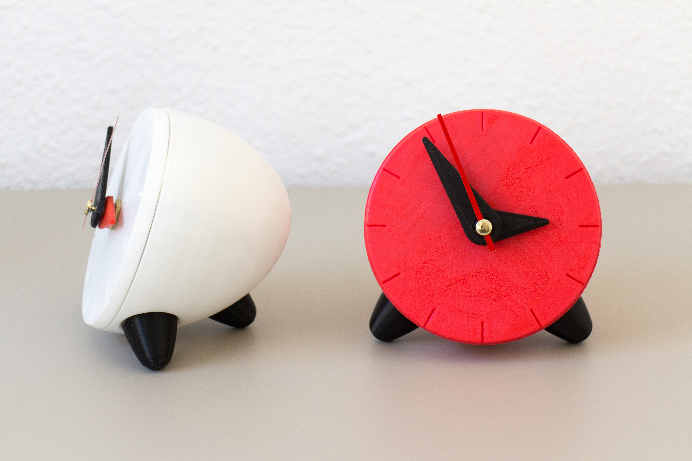 Red and white 3D printed clocks